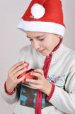 Young boy looking at Christmas present Stock Photography