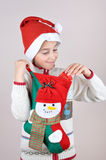 Young boy looking at Christmas present Royalty Free Stock Photography
