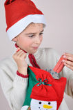 Young boy looking at Christmas present Royalty Free Stock Photo