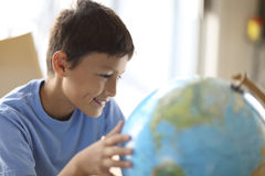 Young boy looking at a globe Royalty Free Stock Photo