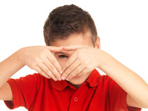 Young boy looking through heart shape Royalty Free Stock Photography