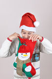 Young boy looking inside Christmas stocking Stock Image