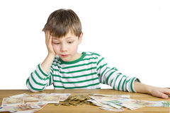 Young boy is looking at a lot of money Royalty Free Stock Photo
