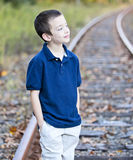 Young boy looking off to the side stock photo