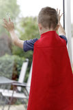 Young boy looking out the window Royalty Free Stock Photo