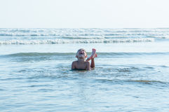 Young boy playing in the sea Royalty Free Stock Photo