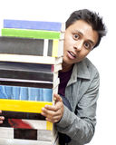 Young Boy Looking Through the Stack of Books Royalty Free Stock Image