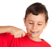 Young Boy Looking To Tooth Brush WIth Paste Royalty Free Stock Images