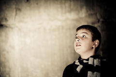 Young boy looking up scaryy Royalty Free Stock Image