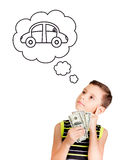Young boy looking up and thinking to buy a car with his money stock illustration