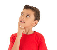 Young Boy looking up and thinking stock photography