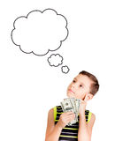 Young boy looking up and thinking what to buy with his money Royalty Free Stock Photos