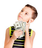 Young boy looking up and thinking what to buy with money Stock Photography