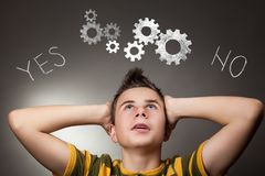 Young boy looking up at Yes and No words. And gear wheels Stock Image