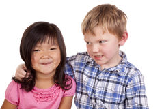 Young boy looking at young girl Stock Photo