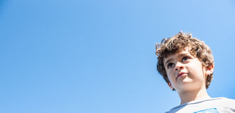 Young boy looks ahead. Stock Photography