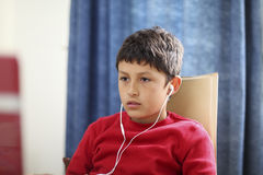Young boy looks blankly at computer Royalty Free Stock Photos