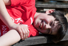 Young boy lying on bench Royalty Free Stock Photography