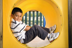 Young Boy Lying in Crawl Tube Royalty Free Stock Photos