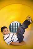 Young Boy Lying in Crawl Tube Royalty Free Stock Images