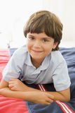 Young Boy Lying Down On His Bed Royalty Free Stock Photos