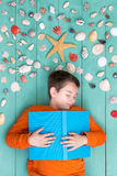 Young boy lying dreaming of a summer vacation stock images