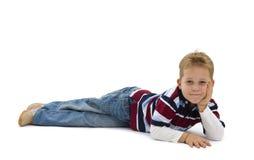 Young boy lying on floor Royalty Free Stock Image