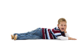 Young boy lying on floor Royalty Free Stock Photography