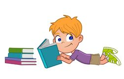Little boy reading. Young boy lying on the floor reading a book Royalty Free Stock Photos