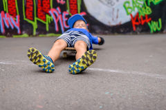 Young boy lying on his skateboard Stock Photography