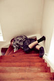 Young boy lying sprawled on a staircase Stock Photos