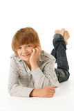 Young Boy Lying On Stomach Royalty Free Stock Photos