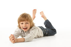 Young Boy Lying On Stomach In Studio Stock Images