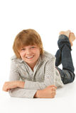 Young Boy Lying On Stomach In Studio Stock Photography