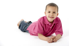Young Boy Lying On Stomach In Studio Stock Photos