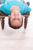 Young boy lying upside down Royalty Free Stock Photography