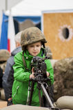 Young boy with machine gun Royalty Free Stock Images