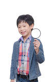 Young boy with magnifying glass Royalty Free Stock Photography