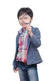 Young boy with magnifying glass Royalty Free Stock Photos