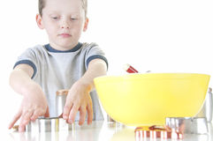Young boy making cookies Royalty Free Stock Images