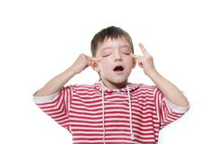 Young boy making faces Stock Photography