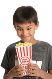 Young Boy Making faces Holding Popcorn Royalty Free Stock Images