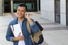 Young boy making fun plans on the phone with space for copy Stock Photo