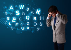 Young boy making phone call with shiny characters Stock Photos