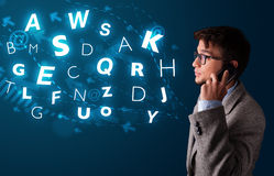 Young boy making phone call with shiny characters Stock Images