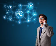 Young boy making phone call with social network icons Royalty Free Stock Image