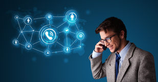 Young boy making phone call with social network icons Stock Photo