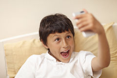 Young boy making selfie pictures Stock Photos