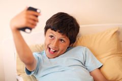 Young boy making selfie pictures Royalty Free Stock Photos