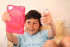 Young boy making selfie pictures Royalty Free Stock Image